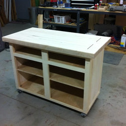 """Rolling island - Raised panel and butcher block - Paid $200 for the butcherblock top and the rest I built with 3/4 plywood and 1x poplar.  4"""" rubber locking casters, raised panel sides and doors."""