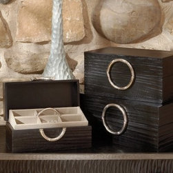 Artisan Black Leather Jewelry Box - With a removable tray and plenty of storage compartments, the Artisan Black Jewelry Box is the perfect place to store your jewelry and other treasures. This sturdy wooden box has leather veneers with a black finish, and metal hardware with a nickel finish. It's available in your choice of size to meet your needs. Whether you're using one box alone or multiples stacked on each other, this jewelry box will make an attractive addition to your bedroom decor. Dimensions: Large: 16L x 10.75W x 7H inches Medium: 14L x 8.75W x 7H inches Small: 12L x 6.75W x 5H inches About Global ViewsGlobal Views is a provider of quality, fashion-driven home furnishings and accents from around the world. Their products range from decorative accents like candelabras and lighting fixtures to benches, chairs, and tables. High-end home decor magazines, such as Elle Decor, Metropolitan, and Traditional Home, have taken notice of the quality and style their products exhibit. Global Views products have also been featured on main-stream TV show sets, including Extreme Makeover Home Edition, HBO Golden Globe, SAG party, and the Apprentice. Always environmentally aware, all Global Views products are made of natural materials, and their packaging is recyclable. Global Views staff members make extra efforts to minimize their carbon imprint by making wise energy choices and promoting recycling programs, carpooling, and waste reduction programs.