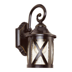 Trans Globe Lighting - New England Rubbed Oil Bronze 13-Inch Coach with Clear Seeded - - Coastal New England horse and carriage hanging lantern. Cross bar frame with rounded seeded glass. Wrought iron wall arm and temple top cap.  - 1 Light Wall Lantern  - Weather resistant cast aluminum  - Cross bar trim all around adds English country accents  - Open at bottom for easy access to replace bulb  - English outdoor lighting collection available in post tops, pendants, and wall lanterns  - Material; Cast Aluminum, Iron, Glass  - Bulbs not included Trans Globe Lighting - 5129 ROB