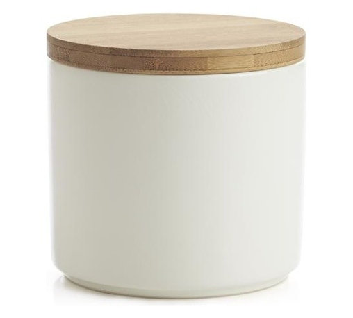 Silo 16 oz. Canister - Clean, contemporary styling in durable stoneware, warmed by a winter-white glaze and natural bamboo lid. Silicone lid gasket forms a tight seal, locking in freshness and locking out moisture. Stackable canisters store staples in style on the countertop or pantry.