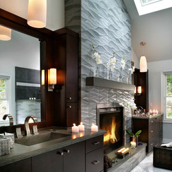 Concrete Bathrooms - Concrete vanities with custom waters edge, integral concrete sink.  Concrete fireplace with optics integrated into mantle for lighting.