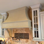 """Mediterranean Remodel - Affordable, lightweight cast stone hood over great potfiller.  Nice antique glass in custom 48"""" high by 15"""" deep cabinets by Kabinart."""