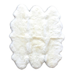 None - Natural New Zealand Sheepskin Rug (5' x 7') - You'll really love the way this naturally made rug will help tie your room together. Add a sense of traditional and rustic style to your residence by adding this lovely area rug to any room in your home.
