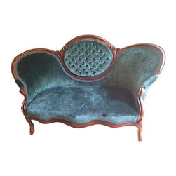 Used Green Velvet Louis XV Tufted Settee Loveseat - A gorgeous vintage French settee with a carved wood frame. The settee is upholstered in a luxe green velvet and has small casters on the feet for easy mobility. The serpentine back has a lovely oval tufted center and an innerspring seat. The uniqueness of this settee will definitely make this piece the star of your room! It is in excellent condition and very comfortable.