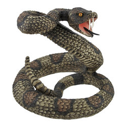 Defensive Coiled Rattlesnake Statue 6 In. - This incredibly realistic resin rattlesnake statue is the perfect addition to Western themed rooms. The snake measures 6 inches tall and approximately 7 inches in diameter. The detail is awesome, from the hand painted eyes to the keeled scales, and it is sure to get attention placed in the corner of a room! This statue is a great gift for snake lovers, and it is a good conversation piece.