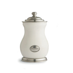 Festivo Farina Canister - Freshen the look of your kitchen with the cafe-inspired Festivo flour canister. Set with a handcrafted pewter medallion whose sweeping yet restrained script advises that the contents are eFarinae (flour), the trim curves of the white ceramic jar rest in a pewter base cast into a turned shape for a stable and professional look. The European ceramic flour jar closes with a weighty pewter lid, its high knob an additional note of tailored chic.