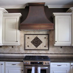 Berenice Copper Range Hood - Copper Range Hood with dark patina and stainless steel insert.