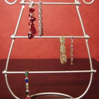 Silver JEWELRY harp BRACELET RACK stand HOLDER gift - Six-Month Financing: Make any purchase on Amazon totaling $149 or more using the Amazon.com Store Card and pay no interest if paid in full within 6 months. Interest will be charged to your account from the purchase date if the promotional balance is not paid in full within 6 months. Minimum monthly payments required. 1-Click and phone orders do not apply. See details and restrictions.