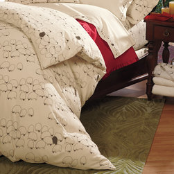 """Grazing Sheep Flannel Duvet Cover - Printed on our soft 100% combed cotton, durable 6 oz. German flannel, this design features original artwork exclusive to Cuddledown. Five of these cuddly sheep are all you'll be able to count before falling fast asleep in this soft warm bedding collection! Duvet Cover has hidden button closure with a 6"""" overlap."""