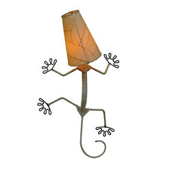 Eangee - Gecko Wall Lamp in Natural - Real fossilized cocoa leaf shade. Dyed with organic dyes and applied with non-toxic adhesives.. The shade is bound to the wrought iron frame with a hand stitched renewable abaca rope.. Wired to be plugged in. 12 in. L x 16 in. W x 24 in. H x 3 lbs.The gecko lamp is a fun and whimsical piece that is designed to stand out. Renewable abaca twine is used a wrap around the entire length of the body, creating a natural look.