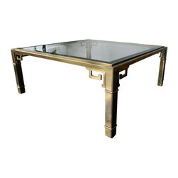 Mastercraft - Pre-owned Mastercraft Brass Greek Key Coffee Table - Stunning, elegant, the epitome of chic. This cocktail table was made in the 1970s by Mastercraft. It features a beveled glass top, a plated brass body and greek key detailing. This classic stunner will be a welcome addition to any space.