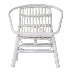 Pre-owned Laguna Rattan Arm Chair in White - This rattan arm chair in a bright, preppy white lacquer is getting us in a tropical mood! Pair it with a sheepskin throw and a fiddle leaf fig tree for a totally spruced up corner of your space. Multiples are available. Please contact support@chairish.com if you are interested in purchasing a pair or more! Dimensions are approximate.
