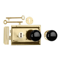 """Renovators Supply - Rim Locks Brass Plated/Black Knob Rim Lock 4.88"""" L x 3.25"""" H - An old fashioned skeleton key Rim Latch. This traditional brass-plated steel Rim Latch easily mounts to a door surface and is reversible. Comes complete with skeleton keys, escutcheon, keeper, 2 knobs, 1 interior brass rose, spindle, and mounting screws. Measures 4"""" h x 6 1/8"""" l. latch proj. 7/16"""". See below for a variety of antique Rim Latch finishes and knob combinations."""