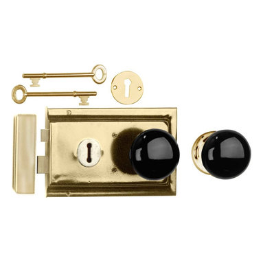 "Renovators Supply - Rim Locks Brass Plated/Black Knob Rim Lock 4.88"" L x 3.25"" H - An old fashioned skeleton key Rim Latch. This traditional brass-plated steel Rim Latch easily mounts to a door surface and is reversible. Comes complete with skeleton keys, escutcheon, keeper, 2 knobs, 1 interior brass rose, spindle, and mounting screws. Measures 4"" h x 6 1/8"" l. latch proj. 7/16"". See below for a variety of antique Rim Latch finishes and knob combinations."