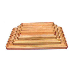 Catskill - Professional Cutting Board with Juice Groove Multicolor - 1322 - Shop for Cutting Boards from Hayneedle.com! The Professional Cutting Board with Juice Groove is made from oil-finished natural yellow birch hardwood which is indigenous to the Northeastern U.S. and ranges in color from blond to a darker walnut shade; the natural variation in color allows this board to coordinate with your existing decor. This board is 1.5 inches thick and can stand up to the most grueling of work loads. A juice groove runs around all four sides of the board keeping your countertop clean and your food where it needs to be. This board is reversible and comes in your choice of sizes. Catskill Craftsmen's Eco-friendly PracticesCatskill Craftsmen is committed to protecting the environment through responsible forest management and manufacturing practices. Located in the Catskill Mountains of upper state New York Catskill Craftsmen plays a role in maintaining the health of the New York City watershed. This watershed provides clean water for New York City and other communities in the area. Healthy well-managed forests are better able to filter pollutants from entering streams and rivers which preserves the quality of watershed resources. With this goal in mind the company supports the efforts of the Watershed Agricultural Council (WAC). With the WAC Catskill Craftsmen encourages lumber suppliers (family forest owners and public land managers) to make wise harvesting decisions and control erosion in order to safeguard water quality. Other efforts to protect the environment include using sustainable wood sources and reducing wood waste. Catskill Craftsmen's manufactured items are made from naturally self-sustaining non-endangered North American hardwoods primarily birch and hard rock maple. All sawdust shavings and waste materials generated during the manufacturing process are converted into wood pellet fuel used to heat homes. This alternative heating source creates less ash and lowe