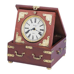 Bulova - Edinbridge Antiqued Desktop Clock by Bulova Multicolor - B7450 - Shop for Clocks from Hayneedle.com! The look of days gone by! Antique metal accents and handles make a dramatic statement on the rustic walnut finish of the wood case. The antique gold tone bezel accents the easy-to-read white dial with stately black Roman numerals. A distinctive look on your nightstand or end table.About BulovaThe Bulova Corporation began as a jewelry market in late 19th century Bohemia; now Bulova has a global reputation for superior clock making. You'll find a wide variety of styles to choose from to complement a mantel or wall in your home or office.History of BulovaJoseph Bulova began a clock and jewelry business in 1875 pleasing customers from the very beginning. In the 1920s Bulova led the way in the clock industry with the first automobile and radio clocks and the corporation continues to lead in innovation and quality.Fine ConstructionMade with the finest marble crystal wood and brass each Bulova clock is engineered with accuracy in mind. You can be sure that the mechanism in the timepiece itself is of superior quality. Bulova clocks are complete with a warranty; certain models offer craftsmanship guarantees.VarietyFor those interested in hobbies Bulova manufactures miniature clocks with unique themes. Interior designers will be pleased with the many Bulova clocks that complement a theme. Many styles are available in floor desktop wall and mantle models; one in sure to satisfy your modern or traditional styling.Specialized CollectionsBulova offers a unique collection of licensed designs. For instance you can find features timepieces with designing from Pfaltzgraff and Frank Lloyd Wright. This collection brings you all of the attraction of licensed designing with the quality and reputation of Bulova.For any area of your home or office whether you are interested in collectible miniatures or impressive grandfather clocks Bulova offers timepieces to suit your tastes and s