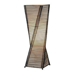 "Adesso - Adesso 4045 Stix Table Lantern - Adesso 4045 Tropical / Safari Stix Table LanternThe frame of each Stix lamp in this collection is a twisting black metal tower. On either side of each corner a thin vertical cane rod is connected to the frame top and bottom. Thin black cane sticks are stacked and woven on each end to those vertical rods, resulting in the appearance of a stick tower. The interior is lined with a fabric-like beige paper and the whole thing stands on four ball feet adorning each corner. Specifications: Takes 1 x 60 Watt Bulb. 24.5"" Height. 7.5"" Square.Adesso was established in 1994 based on the belief that there was an under-served niche among consumers who sought high-end, contemporary home products at moderate prices. Since then, Adesso has not only revolutionized the home industry with its innovative products, but also gained substantial recognition for its well-designed and well-priced lamps and RTA furniture. From the onset, when Adesso first introduced its lighting products, an array of colors and materials were utilized in the design, including metals, rice-paper, woven fabric, glass, resin, renewable bamboo wood and cork! These materials help make every Adesso product beautifully unique, adding a perfect touch to any home.Features:"