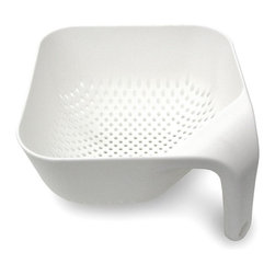 Joseph Joseph - Joseph Joseph Square Colander Large, White - This ergonomically designed colander has several unique features. Firstly, the single vertical handle ensures it remains upright and stable whilst rinsing and draining and leaves one hand free for operating the tap. Secondly, its square shape fits perfectly into the sink and makes serving rinsed food easier. Lastly, the large vertical holes allow liquids to drain away quickly. Available in green, black, red, and white.