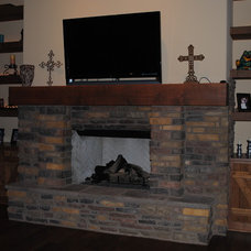 Traditional Indoor Fireplaces by Woodland Custom Beam Company