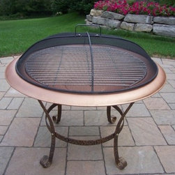 Oakland Living - Grill Fire Pit - The Oakland Fire Pits Collection combines functional and modern designs giving you a rich addition to any outdoor setting. The solid and sturdy yet trendy designs of the Oakland Fire Pits collection will be the talk of your neighborhood. These fire pits will make the prefect center piece at any outdoor get together. Each piece is hand cast and finished for the highest quality possible. Features: -Can fit three to five logs.-Can use charcoal for grilling.-Weathered scrollwork legs and support ring.-Full-size screen dome cover with handle.-Large grill grate included for outdoor cooking.-Constructed of cast iron.-Features a hardened powder coat finish for years of beauty.-Distressed: No.Dimensions: -Dimensions: 25'' H x 30'' W x 30'' D.-Overall Product Weight: 40 lbs.