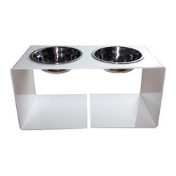 the raised Minimalist Feeder : elevated dog bowl - Modern minimalist design. Stark white acrylic frame in a high gloss finish. Removable stainless steel bowls, 2.5 cup capacity. Designed for cats and medium to large-sized dogs.