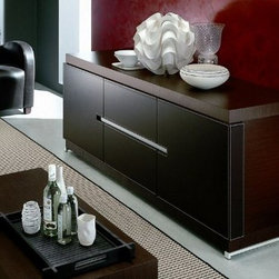 ROSSETTO CITY WENGE BUFFET - Solid construction and sophisticated details give the City Buffet a definitive WOW factor. Three large doors reveal expansive storage, while aluminum detailing adds a subtle accent to the durable and high quality dark wood finish. The three doors are covered with dark brown eco-leather and detailed with contrast stitching. One shelf behind each door expands the storage functionality for all your dining and entertaining essentials.
