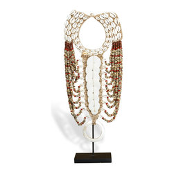 Kathy Kuo Home - Merkato Global Bazaar Shell Beaded Tribal Necklace - Museum quality beauty can grace your home with this handcrafted, global bazaar tribal necklace. Earth tone beads accented by iridescent shells and polished wood shimmer on the simple, stylish display stand.