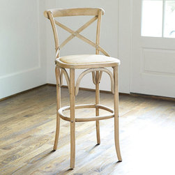 "Ballard Designs - Constance Barstool - Hand crafted of solid birch. Multi-step, hand applied finish. Coordinates with our Constance Dining Chair. Frames made of birch or oak. Woven seat is padded so a cushion is not required. Reminiscent of a classic Thonet bentwood chair from the mid 1800s, our Constance Barstool has a contoured, steam-bent ""X"" back that cradles you for surprising comfort. The hand woven rattan seat adds texture and charm.Constance Barstool features: . . . . ."