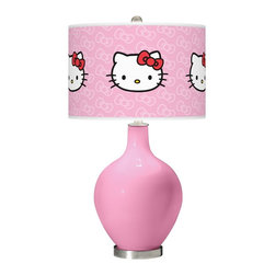 "Hello Kitty - Contemporary Pale Pink Hello Kitty Classic Ovo Glass Table Lamp - Add a bold cheerful accent to your home décor with this pale pink Hello Kitty Classic glass table lamp. Hand-crafted by experienced artisans in our California workshops the pale pink high-gloss base is topped with a matching Hello Kitty Classic pattern shade officially licensed from Sanrio. This contemporary design brings the iconic Hello Kitty to life on a custom-printed giclee shade made of high-quality translucent fabric that allows light to shine through the shade. U.S. Patent # 7347593. Officially licensed design from Sanrio. Pale pink designer glass table lamp. Pale pink Hello Kitty Classic pattern translucent shade. Brushed steel finish accents. Maximum 150 watt bulb (not included). 28 1/2"" high. Shade is 15 1/2"" wide and 11"" high. Base is 6"" wide. May only ship to the United States its territories possessions and the Commonwealth of Puerto Rico. ©1976 2013 Sanrio Co. Ltd. Used Under License.  Officially licensed design from Sanrio.   Pale pink designer glass table lamp.   Pale pink Hello Kitty Classic pattern translucent shade.   Brushed steel finish accents.   Maximum 150 watt bulb (not included).   28 1/2"" high.   Shade is 15 1/2"" wide and 11"" high.   Base is 6"" wide.  May only ship to the United States its territories possessions and the Commonwealth of Puerto Rico.  ©1976 2013 Sanrio Co. Ltd. Used Under License."