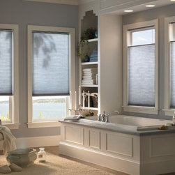 Cellular Shades - Cellular Shades are available with multiple operating systems to choose from. They are constructed from a polyester fabric to repel dust and dirt and are available in a wide variety of colors. These shades are designed with energy efficiency in mind, providing both superior energy and sound insulation.