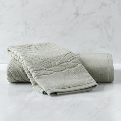 Frontgate - Seychelles Sculpted Bath Towel - 100% MicroCotton® woven to 580 gram weight. Lightweight yet highly absorbent. Sculpted palm design with subtle nautical rope border. In White, Bisque, Reef, Seacove and Coastline. Machine wash warm with like colors, delicate cycle; do not bleach; tumble dry low. Wrap yourself in the simple serenity and plush luxury found in coastal resorts. Our 580 gsm Seychelles Towel Collection soothes with sculpted, stylized palm leaves, sunwashed shades and super-soft MicroCotton. The dense double-loop construction delivers twice the absorbency of standard towels, with quick-drying ease. 100% MicroCotton woven to 580 gram weight .  .  .  .  . Imported.