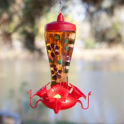 Garden Song Handpainted Glass Funnel Bird Feeder - The Perky-Pet Garden Song Hand-Painted Glass Funnel Hummingbird Feeder has a beautiful design that will attract hummingbirds from all around.It features a patented reversing funnel cap that makes filling and cleaning easy and can hold up to 10 oz. of nectar. The feeder has a durable, tempered clear glass bottle that is hand-painted with a striking floral design as well as four sculpted feeding flower ports.For best results, use Perky-Pet Instant Nectar. This specially blended nectar is easy to use, and requires no boiling. Remember to clean your feeder every 2-3 days with mild soap and water solution. The feeder may be cleaned with the Perky-Pet Cleaning Mop.