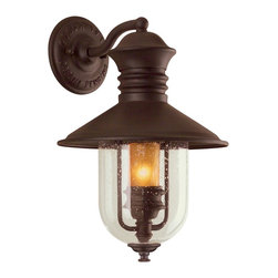 "Troy - Country - Cottage Old Town Collection 16"" High Outdoor Wall Light - From the Old Town outdoor lighting collection this wall mount design features a rustic look in a natural bronze finish. Wall plate and top cap are in hand- forged and cast iron. A clear seeded glass shade with an inner amber colored cylinder gives a unique lantern style look. Takes one 60 watt candelabra bulb (not included). 16"" high. 10 1/2"""" wide. Extends 11"" from the wall.  Natural bronze finish.  From the Troy Lighting collection.  Clear seeded glass with amber cylinder.  Takes one 60 watt candelabra bulb (not included).   16"" high.   10 1/2"" wide.  Extends 11"" from the wall."