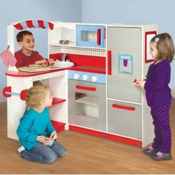 Guidecraft Cooks Nook Kitchen - Turn that empty corner of your child's playroom into a mini kitchen with the Guidecraft Cook's Nook Play Kitchen. The L-shaped design is ideal for maximizing play space, and it includes all the mainstays found in a real kitchen, including a microwave, refrigerator and freezer, oven and stove with clicking knobs, and sink and faucet. The decorative awning, dry-erase board, exterior chalkboard, and serving window allow for several children to play at once and allows them endless play scenarios. The bright colors, bold graphics, and chunky handles makes this play kitchen stand out. Your child can add their own play food and utensils to add to the storage shelves. About GuidecraftGuidecraft was founded in 1964 in a small woodshop, producing 10 items. Today, Guidecraft's line includes over 160 educational toys and furnishings. The company's size has changed, but their mission remains the same; stay true to the tradition of smart, beautifully crafted wood products, which allow children's minds and imaginations room to truly wonder and grow. Guidecraft plans to continue far into the future with what they do best, while always giving their loyal customers what they have come to expect: expert quality, excellent service, and an ever-growing collection of creativity-inspiring products for children.