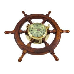 Oak Ship's Wheel Clock Brass Porthole Nautical 24 Inch Wide - This unique 24 inch diameter ship's wheel clock feature a solid oak ship's wheel with six spokes. In the center of the wheel, a solid brass, opening porthole style quartz clock, with a 6 inch diameter face, displays both 12 and 24 hour display. A red second hand provides up to the moment time. It looks great in the home or office and makes a wonderful retirement or birthday gift. This clock requires one AA battery.