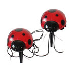 Smart Solar - Solar Ladybugs - 4-Piece Set - Solar powered, decorative ladybug lights ideal for decorating shrubs, flower beds and outdoor areas. Powered by a separate solar panel allowing lights to be placed in shady areas. Overall cable length is 20 ft with 5 ft between the solar panel and each light. 1 red LED per ladybug with total of 4 ladybugs. Automatically illuminates at dusk and turns off at dawn. Up to 8 hours of light each night when fully charged. Replaceable, rechargeable Ni-MH battery. Stake mounting allows lights and panel to be located easily in the garden. No wiring, simply install and enjoy. No operating costs.