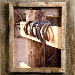 MyBarnwoodFrames - 8x10 Cowboy Picture Frames, 2.5 inch Wide, Western Rustic Series - Cowboy  Picture Frames      Cowboy  Picture  Frames  are  some  of  our  favorites  to  create.  Our  western  decor  enthusiasts  have  an  appreciation  for  barnwood  that  city  folk  just  can't  always  understand.  To  them,  barnwood  just  looks  old,  but  a  more  practiced  eye  can  detect  subtle  color  variations  and  rich  textures.  Of  course,  you  can  appreciate  nature  in  a  way  that  those  who  only  view  fields  of  sagebrush  from  inside  their  air-conditioned  cars  can't.  They don't  see  the  wildflowers,  the  scorpions  and  the  circling  hawks  either.          Maybe  you  can't  dismantle  the  weathered  barn  and  bring  it  indoors,  but  you  can  give  prominence  to  some  of  that  beautiful  rustic  wood  with  one  of  our  Western  Rustic  frames. Our  cowboy  picture  frames  case  a  ¾  inch  plank  edge  inside  a  1-½  inch  rustic  wood  frame.        The  frame width  is  approximately  2.25  inches  (frame  widths  sometimes  vary  depending  on  the  width  of  the  original  barnwood  plank). This  frame-inside-frame  look  lends  itself  especially  well  to  western  rustic  subject  matter. Your  frame  includes  glass,  foam  board  backing  and  hardware  for  hanging.          Here's  the  perfect  cowboy  picture  frame  for  that  photo  of  your  daughter  on  her  first  pony  ride,  a  sunset  on  the  ranch,  or  a  painting  of  flowering  cactus.  The  unique  casing  also  makes  these  rustic  western  frames  a  great  choice  if  you  want  to  create  a  shadowbox  for  your  grandfather's  bolo  tie  clasp,  a  lucky  horseshoe,  or  a  few  dried  wildflowers. This  style  looks  great  when  paired  with  one  of  our          collage  frames.  This  is  authentic western  rustic decor  at  its  best.           Click  here  to  view  our  entire  inventory  of  Western  and  Cowboy  Frames            Product  Specifications:                 Frame  is  crafted  from  authentic  barnwood      Frame  width:   2.25  inches      8x10  photo  opening    Glass  is  included    Sawtooth  hanger                   Please  note:   Due  to  the  nature  of  barnwood,  your  cowboy  picture  frame  may  vary  slightly  in  color  and  texture  from  the  one  pictured  here. Photos  are NOT  included.