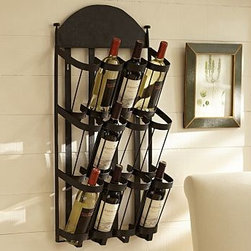 """Vintners Wall-Mount Wrought-Iron Wine Rack - This space-saving rack recalls those used in classic San Francisco restaurants, where the latest Napa Valley wine found its way into the hearts and minds of residents and visitors alike. 16"""" wide x 7"""" deep x 33.5"""" high Made of steel with a rustic bronze finish. Holds twelve bottles of wine. Mounting hardware included."""