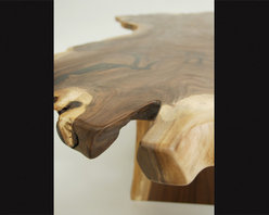 """The Book-Matched Slab Table - Two Black Walnut slabs milled from the same tree were joined or """"book-matched"""" to seamlessly create one sculptural piece of wood. The Book-Matched Slab table designs are as boundless as the unique qualities found in each slab we mill. All of these pieces come from storm-damaged trees taken down by municipalities and utility companies.  Slab tables are available in a variety of sizes and designs.  Please call 406-582-0711 for pricing and ordering information, or email us at sales@brandnerdesign.com."""