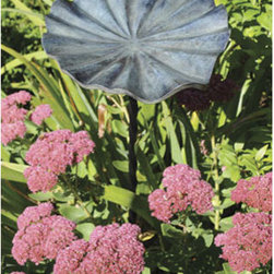 Small Lily Leaf II Birdbath - The lily leaf bowl of this birdbath gives this standout a natural feel even though it's made of metal. I like that it sits on a slim stake because it feels more like one of the flowers nestled in a bed.