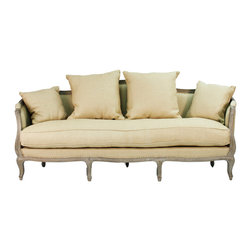 Maison Sofa - Limed Grey Oak with Hemp Linen - The calm, classic presence of the Maison Sofa is primarily derived from the gracefully continuous design of this traditional cabriole sofa's sleekly rounded back and arms. Made from limed grey oak and hemp fabric, equipped with four pillows in two convenient sizes for perfectly customizable comfort, the sofa presents an outline which looks for the artistry possible in seating arrangements.
