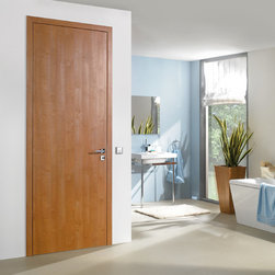 "Laminated Doors - ""Nutmeg"" - ""Nutmeg"" is a smooth finish laminate.  Laminate doors are a terrific alternative to real wood or wood veneer which are easy to clean, scratch resistant, durable and best of all affordable.  All Bartels laminated door products are provided as complete door systems including jamb and casing, door panel and all necessary hardware.  Laminated panels may also be ordered as  pocket doors or slabs only for use with sliding systems and Modern Barn Door Hardware."
