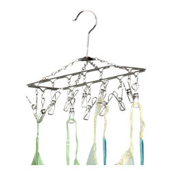 Honey Can Do - Hanging Drying Rack- Chrome - Folds flat. Convenient storage. Chrome finish. Protects delicate fabrics. Metal hanger. Stury and secure. 4.75 in. L x 11.75 in. W x 6 in. H (0.94 lbs.)Honey-Can-Do DRY-01102 Hanging 12-Hook Lingerie Dryer, Chrome. Extend the life of your delicates by air-drying with a Honey-Can-Do 12-Hook Lingerie Carousel. No need to hang your unmentionables all over the house to dry; this item is capable of hanging up to 12 pieces in a square foot of space. It features a convenient hanging hook that fits perfectly on a closet bar or shower rod. An upgrade from standard plastic carousel hangers, the chrome finish is beautiful, rust-resistant, and sturdy, plus folds flat and stores easily when not in use. It is the perfect solution for keeping your delicates looking their best. Repurpose and use for drying other items such as herbs or flowers.
