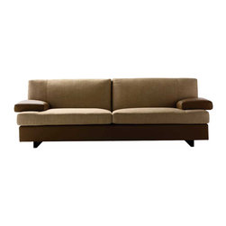 Poltrona Frau - Poltrona Frau Eskilo Sofa - Defined by clean, neat lines, the Eskilo Sofa gives personality to the living room. A functional designcombined withwelcoming forms, allows for pleasant daily use. The back cushions are available in a higher version to  a greater degree of comfort. The frame is made of seasoned beech wood with goose feather cushions and a polyurethane foam stabilizing insert. It can be upholstered with Pelle Frau leather with quilted stitching or with cushions covered in fabric, or in combination of leather and fabric. The feet are made from black, painted wood. The collection includes a sofa bed and alarge ottoman with self-locking swivel casters. Price includes delivery to the USA. Manufactured by Poltrona Frau.Designed in 2006.