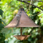 Covered Copper Bird Feeder - Hang this attractive feeder outside your favorite viewing window. It's flared hood and brass rivets impart a look of old world charm and help to keep the rain off the open feeding cup.