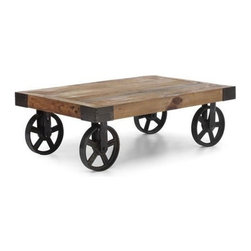Cart table Barbary Coast - Cart Table Barbary Coast consists of solid elm wood top mounted on antiqued metal wheels . Its remarkable and a bit underground design is inspired by the original industrial cart used to transport furniture, fabric and supplies across the factory in early 1900s.