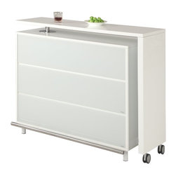Chintaly - Chintaly Barclay Home Bar - Gloss White - CTY1376 - Shop for Bars and Bar Sets from Hayneedle.com! Modern versatility lives in the Chintaly Barclay Home Bar - Gloss White. A smart space-saving way to entertain this home bar is versatile. The top counter may be moved in a variety of ways. The bar itself features a variety of open and tucked away shelves for storage. When the party's over this home bar folds and features smooth rolling casters to tuck into a corner. About Chintaly ImportsBased in Farmingdale New York Chintaly Imports has been supplying the furniture industry with quality products since 1997. From its humble beginning with a small assortment of casual dining tables and stools Chintaly Imports has grown to become a full-range supplier of curios computer desks accent pieces occasional table barstools pub sets upholstery groups and bedroom sets. This assortment of products includes many high-styled contemporary and traditionally-styled items. Chintaly Imports takes pride in the fact that many of its products offer the innovative look style and quality which are offered with other suppliers at much higher prices. Currently Chintaly Imports products appeal to a broad customer base which encompasses many single store operations along with numerous top 100 dealers. Chintaly Imports showrooms are located in High Point North Carolina and Las Vegas Nevada.