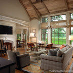 True Divided Lite Wood Windows - Oversized true divided lite windows in this living area are flanked by double hung windows and a bank of overhead transom windows by Dynamic Architectural Windows & Doors.