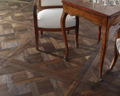 French Oak Collection- Parquet de Versailles- St. Amour- Francois & Co. - Solid parquet wood floors made from French Oak. These floors are aged, pre-finished and ready to install. They are beautifully aged according to the old traditions and present scuff marks, some worm holes and aged, uneven edges.