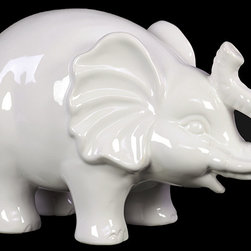 """Benzara - Happy and Cheerful Trumpeting Ceramic Elephant in White (Large) - Place this charming and cute decor item on your shelf, table, or mantle place and let its cheerful and sunny nature add love and life throughout your home. Sporting a glossy sleek finish, the elephant figurine has its trunks raised as if to trumpet. This beautifully carved figure is made from ceramic and its white color and beautiful sleek glossy texture is sure to delight one and all. The dimensions of the Happy and Cheerful Trumpeting Ceramic Elephant in White (Large) are 10.5""""x5""""x6.5""""H. Ceramic; White; 10.5""""x5""""x6.5""""H; Dimensions: 11""""L x 5""""W x 7""""H"""